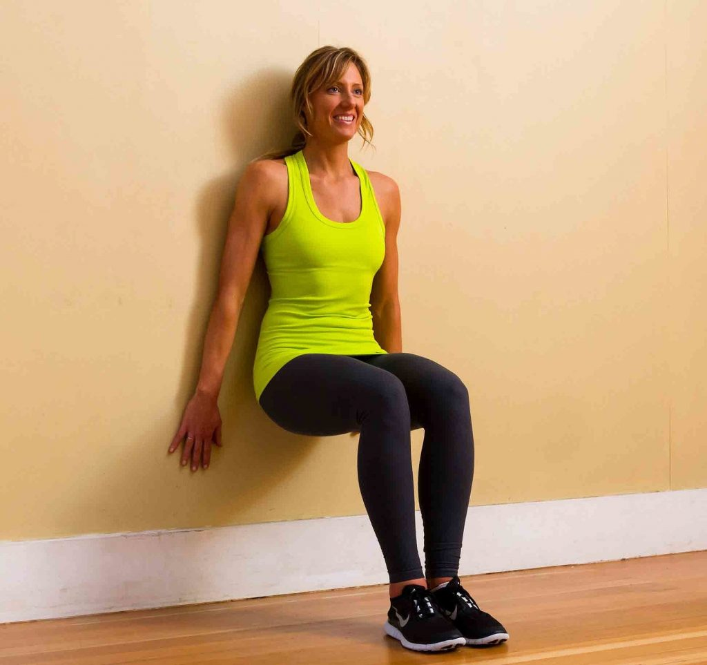 Wall Squats. Ways to be Motivated to Workout