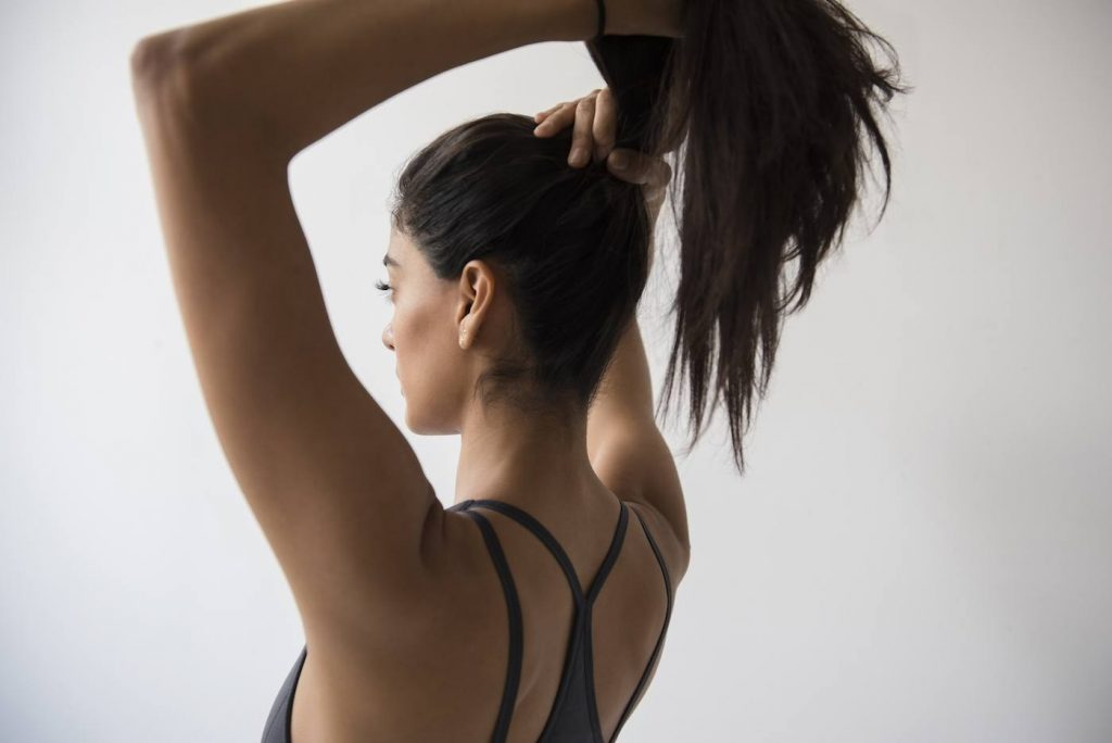 Tie Those Loose Strands of Hair. What to Wear When Working Out at the gym
